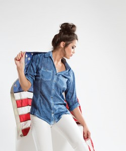 Bent Oaks Boutique This three quarter sleeve, cotton shirt has a woven garment dyed design to  imitate a denim shirt. Perfect for summer weather, this top is paired with white stretch pants.