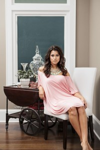 BENT OAKS BOUTIQUE Both chic and comfortable, this off-the-shoulder dress in blush has 3/4 length sleeves. Accent the look with a statement necklace in a complimentary color. This dress is great for date night.