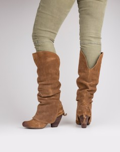 Beau Monde Boutique Make a trendy statement with these suede slouch boots. They feature a lace-up fringe accent at the heel and fold-over shaft with rounded toe.