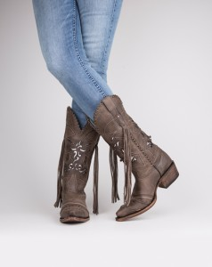 Maison Couture Clothiers These boots are great for the cowgirl diva in your life. Made with fringe and braided details, these boots also feature interchangeable inlays.