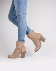 The Pelican District Strut it in these fashionable ankle booties that feature a faux suede material and zip up closure. The laser-cut details add a stylish finish to these cute kicks.