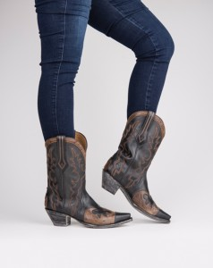 Salt & Pepper  These cowgirl boots are a great pick for any wardrobe. Featuring black and tan leather with feminine details, these boots are a must-have for fall.