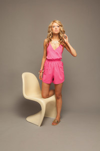 BEAU MONDE  Ellie looks pretty in pink in this one-piece romper from Beau Monde in Ruston. Accessorize with these charming gold slip-on sandals, layered Bourbon & Bowties bracelets and statement necklace.