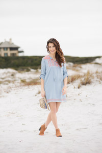 PELICAN DISTRICT We adore this tunic dress with 3/4 length sleeves. The coral and white embroidered detailing and tassel ties add an exotic twist. Pair with a laser-cut bootie and fun hat for a look that is sure to turn heads.