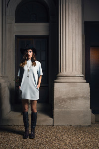 DUCK & DRESSING Take to the streets in this oversized t-shirt style dress and this season's must-have boot. Detailed with classic lines and easy heel, this tall boot has lacing at the top of the shaft and an inside zipper for a great fit. Paired with a tassled hat and key  necklaces, this look is sure to set you apart.