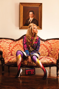 WE BRIDGED DECADES OF PUCCI DESIGNS WITH A VINTAGE PRINTED VELVET TUNIC AND MODERN THIGH HIGH BOOTS.