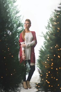 PATTON'SDOWNTOWN Ellie looks comfy cute in this creamy long-sleeve top with deep red cardigan with tassels. It is paired with a dark denim skinny jean, boots with fringe detailing and stackable bracelets.