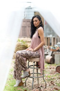 ERIN'S ATTIC This sultry snakeskin print slithers down these faux-suede pants which are combined with a soft, side-slit tunic with fringe detailing. Add a metal statement necklace with earrings and these fabulous fringed wedge sandals with suede upper and stud details.