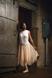 Beehive This outfit is anything but behind-the-scenes. We love the simple white tank  paired with a blush-colored, layered tulle skirt. A simple necklace with tassel and charm embellishments complete the look.